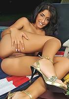 Hot latina Izabella stuffing a cucumber outdoor