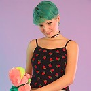 Fun girl with green hair shows off her world class ass.