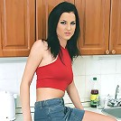 Sexy brunette naked on the kitchen counter