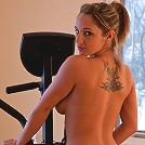 Nikki gets sweaty and naked on the Elliptical