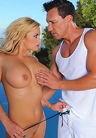 Busty blonde Shyla Stylez sucks big cock and rides it hard at the pool