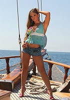 Sexy brunette Rita Faltoyano puts her clothes off and shows big boobs and pussy on the yacht
