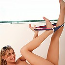 Charming Meggan Malone strips her undies teasing on the floor stroking her pink hole with a toy