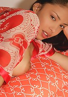 Hot Alexis on her bed wearing her smoking hot red robe fingering her tight asian pussy