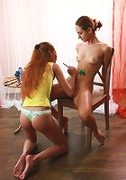 Petite redhead teen drawing pictures on the naked body of her friend