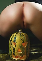 Trick or Treat! Beautiful brunette teen with the pumpkin-head