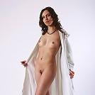 Natural brunette babe Femida spreading her legs