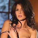 Jenni Lee is a wild brunette with black fishnets and a corset
