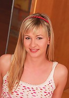 Babelicious.com (Pics) - Tarra K - Blonde Tarra K sits on the floor to show her hot petite body