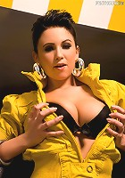 Chloe J literally peels herself, like a banana, out of her retro 90s bright neon yellow jacket and skin-tight leather pants both of which barely contain the hot brunette's ample cleavage and curvaceous ass!