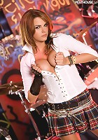 Meggan Mallone rocks out and strips out of her trashy Catholic school girl mini-skirt onstage at an underground punk rock dive bar!