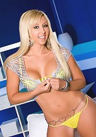 Jessica Lynn's deep blue eyes and light blonde hair match the Penthouse blue room and her yellow bikini, but really the only color we're interested in are her red lips and her pink nipples and pussy!