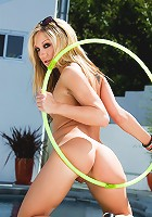 Amy Brooke is having way too much fun hula-hooping in the buff in her backyard. You'll be mesmerized by her gyrating hips and swaying boobs as she works the hoop round and round!